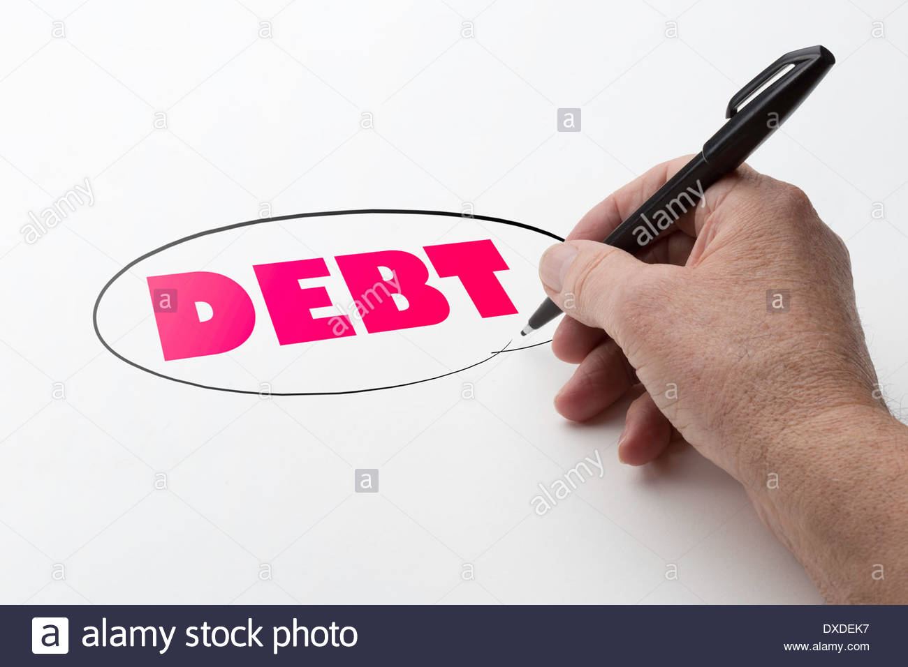 Man hand holding a black pen and encircling the word debt. - Stock Image