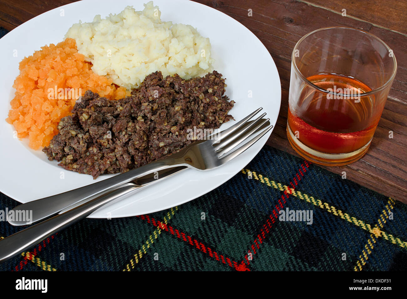 Traditional Scottish haggis, neeps and tatties with whisky also known as a burns supper. Stock Photo
