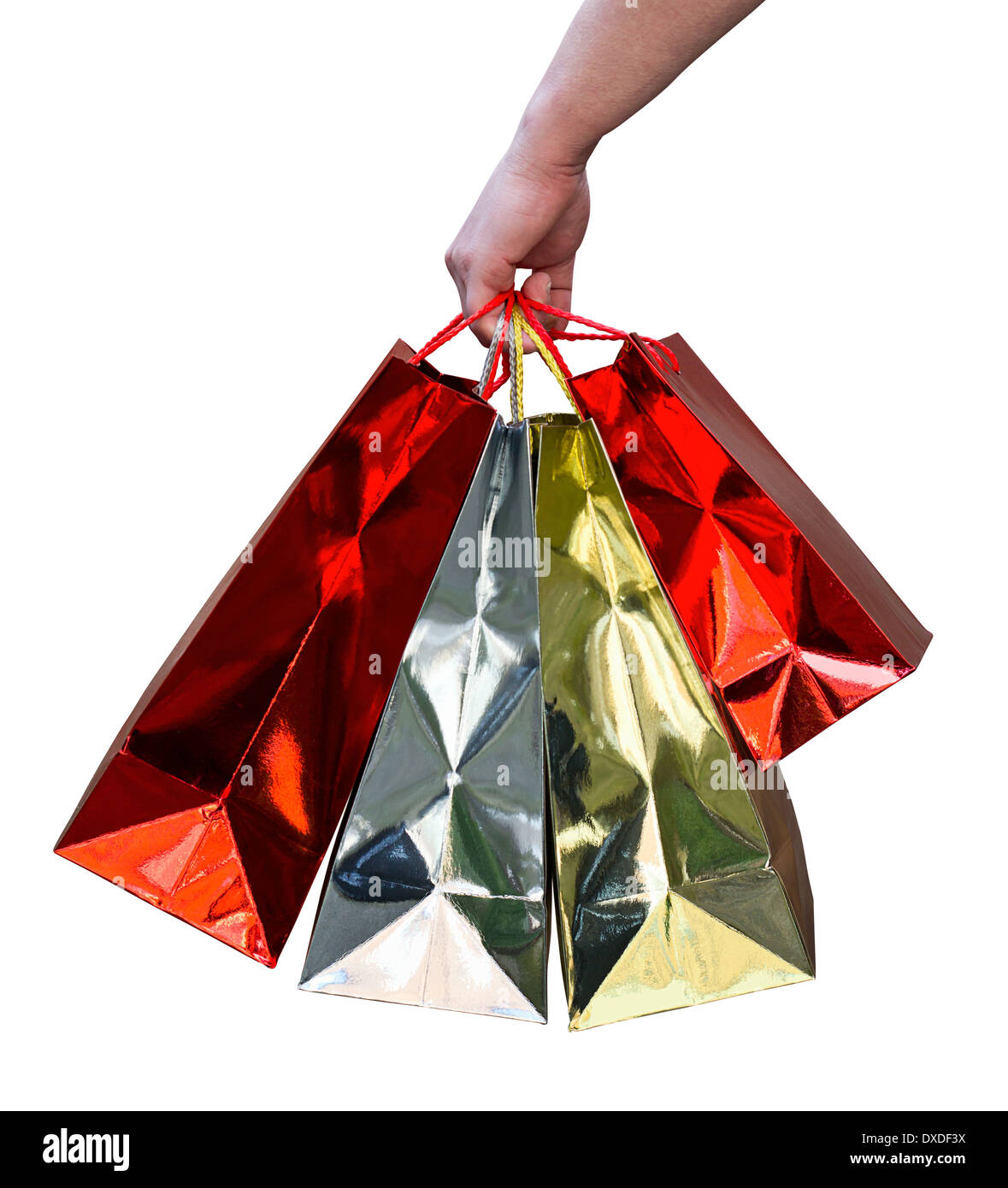 Hand carrying red and gold shiny gift bags of shopping purchased from a mall - Stock Image