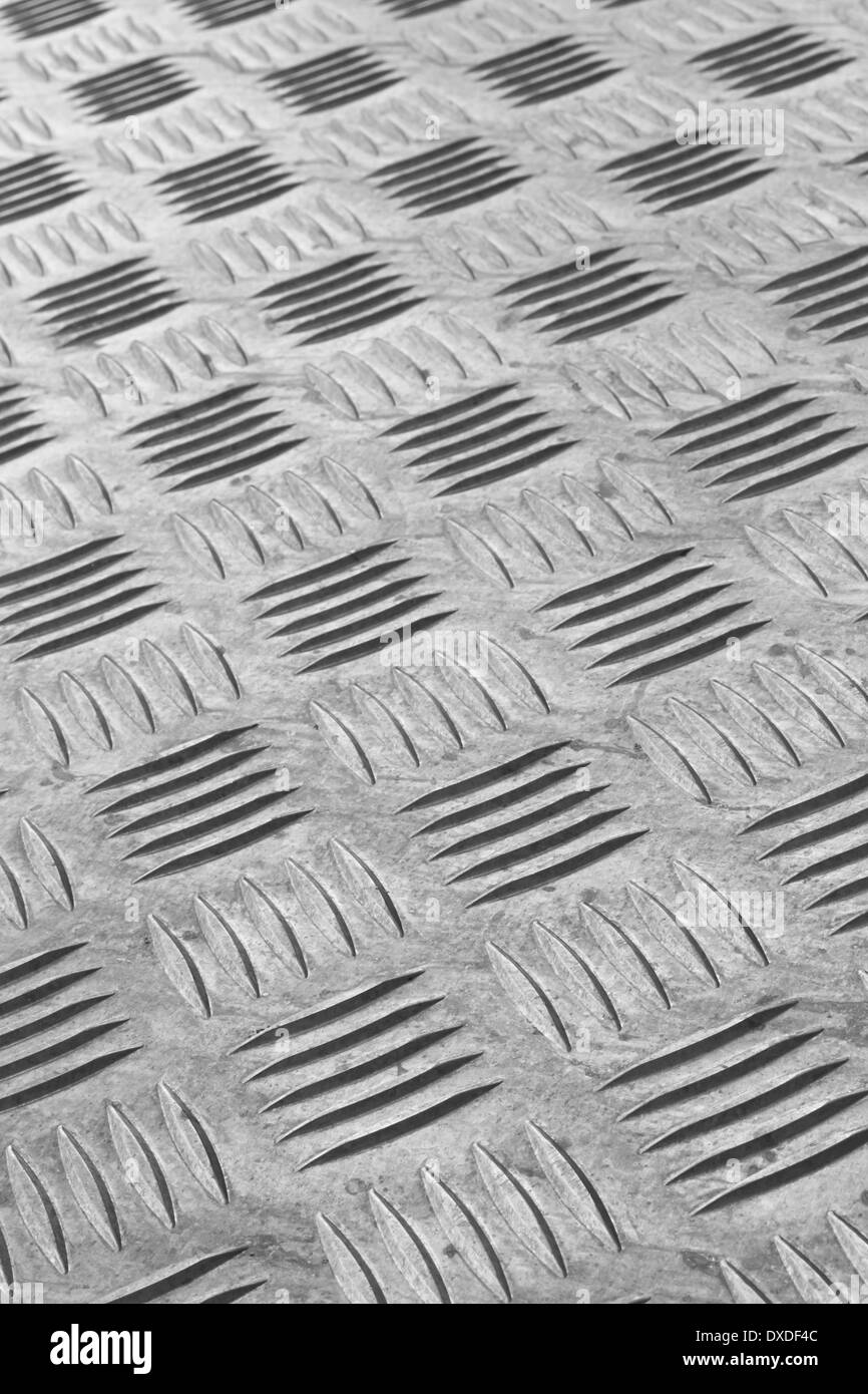 Industrial non-slip metal flooring detail - Stock Image