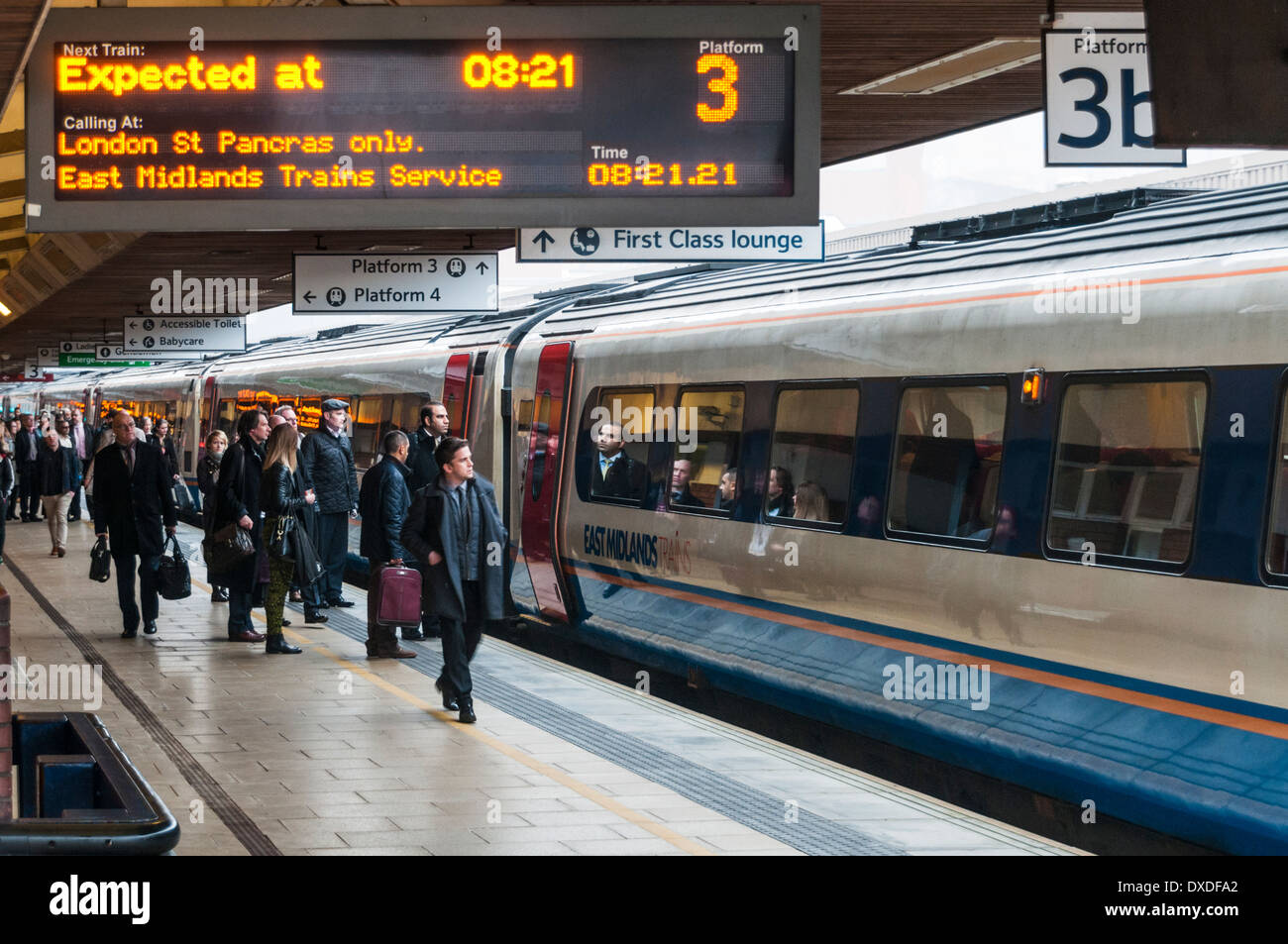 Passengers joining an East Midlands non stop express train to London at Leicester railway station - Stock Image