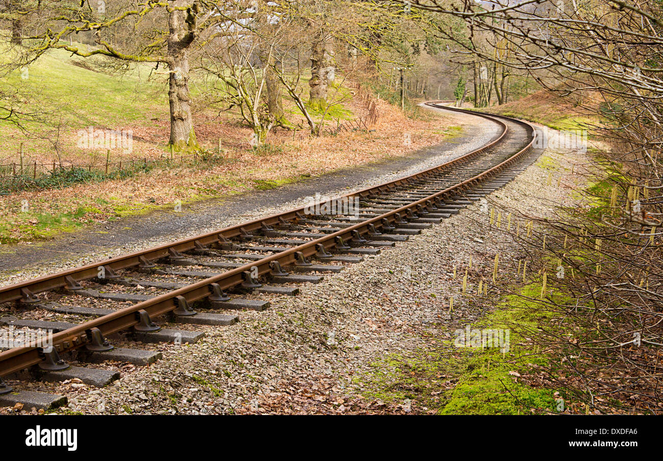 Heritage railway train tracks forming an S curve through a rural setting. - Stock Image