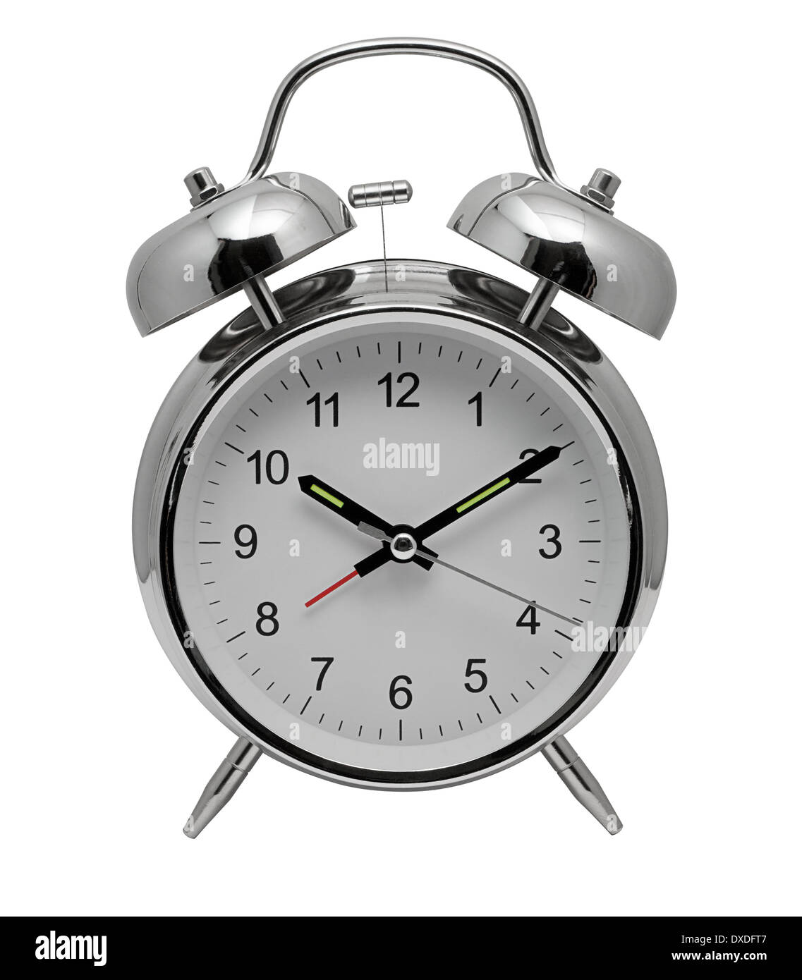 Traditional chrome metal Alarm Clock with bells and ringer on top to awaken you from sleep in the morning - Stock Image