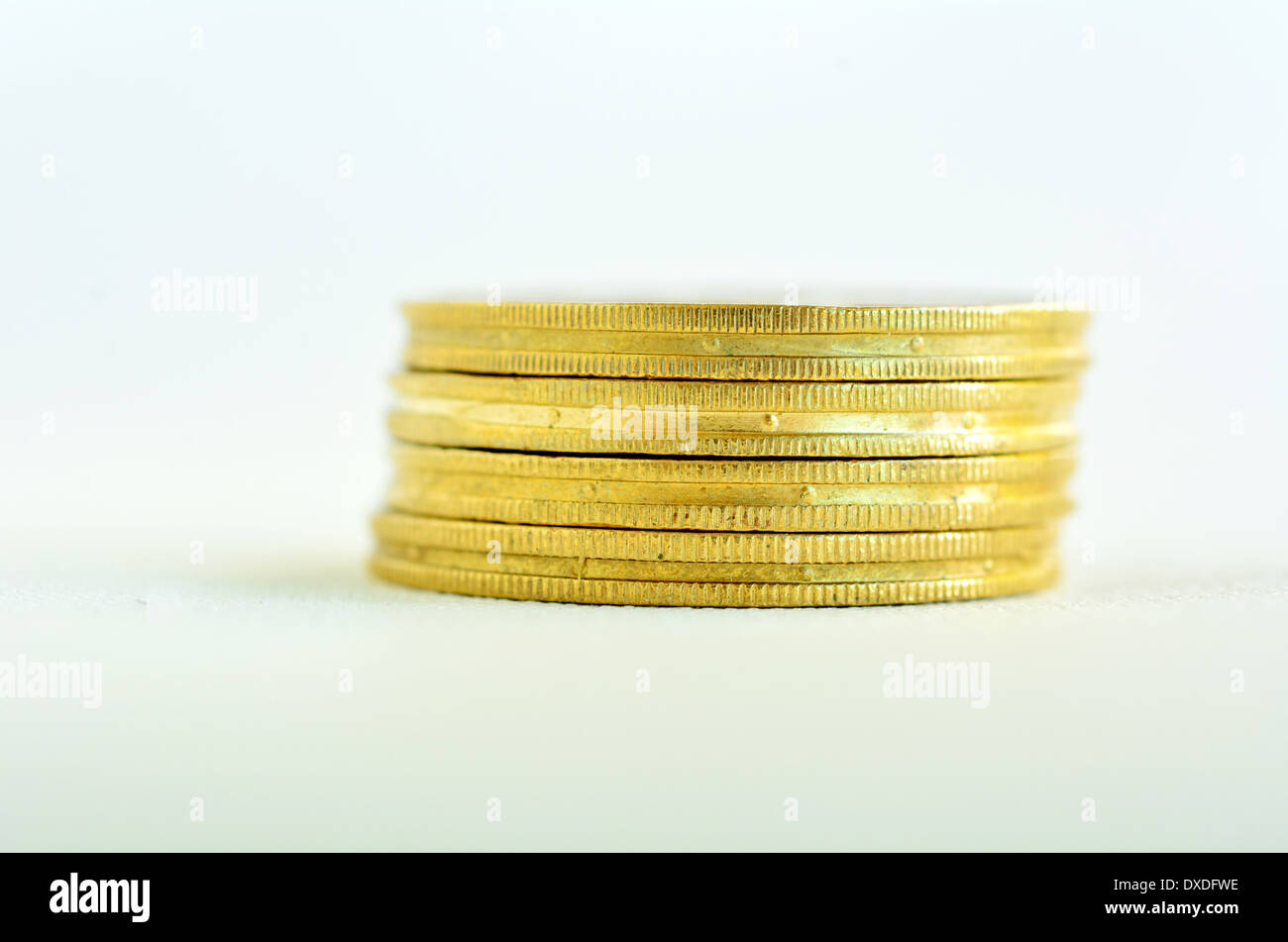 One small Golden gold coins stack isolated on white background. Concept photo of bank, money, banking, finance, economy, - Stock Image