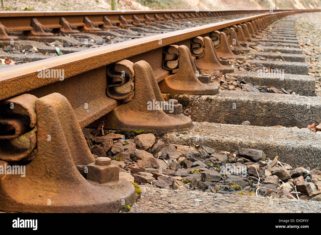 Heritage rail road train tracks extreme close up and fading into distance. - Stock Image