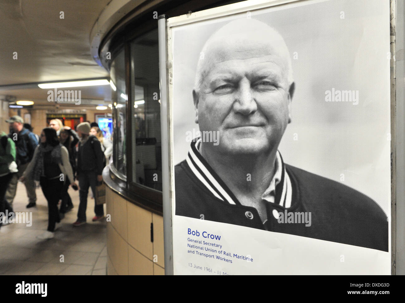 Leicester Square Station, London, UK. 24th March 2014. Evening commuters pass a poster of the late Bob Crow General Secretary of the RMT Union in Leicester Square station. Credit:  Matthew Chattle/Alamy Live News - Stock Image