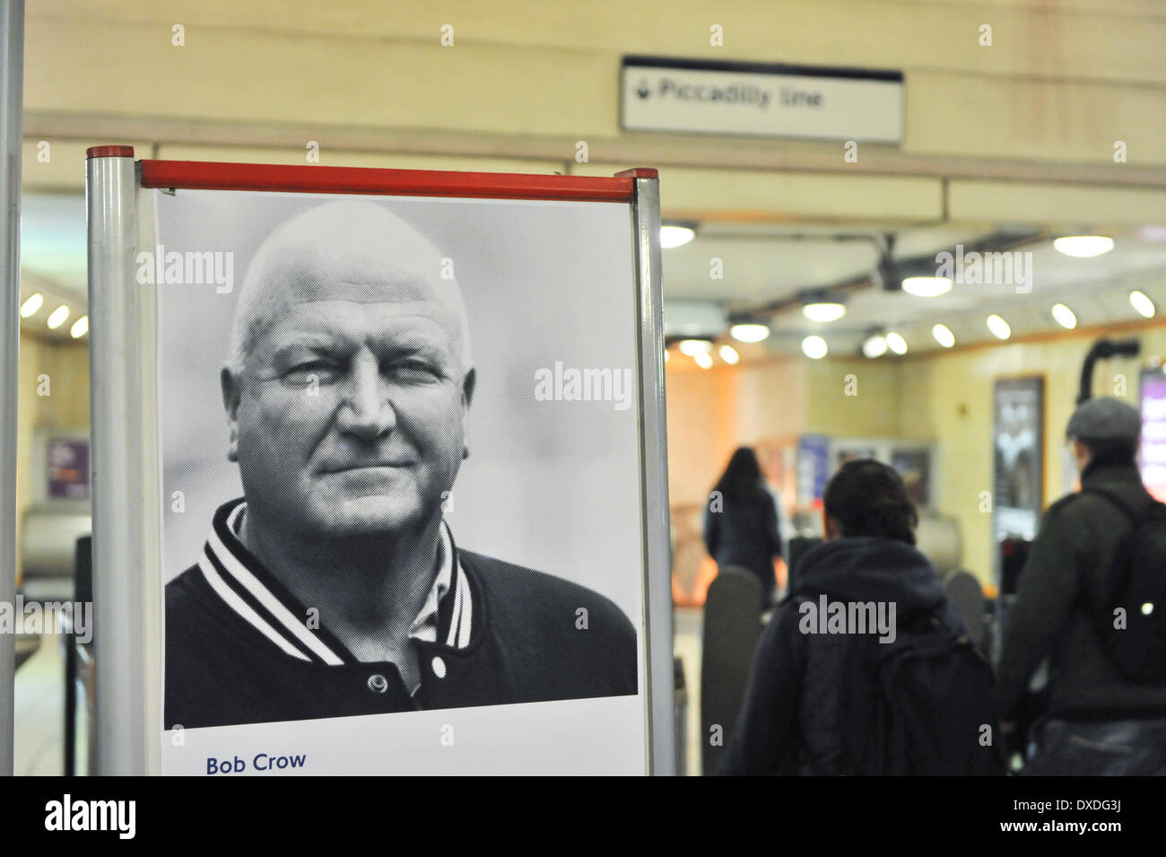 Turnpike Lane Station, London, UK. 24th March 2014. Evening commuters walk past a poster of the late Bob Crow, the General Secretary of the RMT Union, in Turnpike Lane station on the day of his funeral. Credit:  Matthew Chattle/Alamy Live News - Stock Image