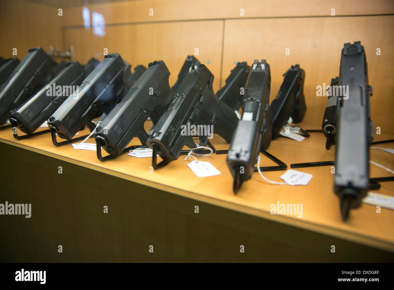 Display case with handguns at a gun store in Austin, Texas - Stock Image