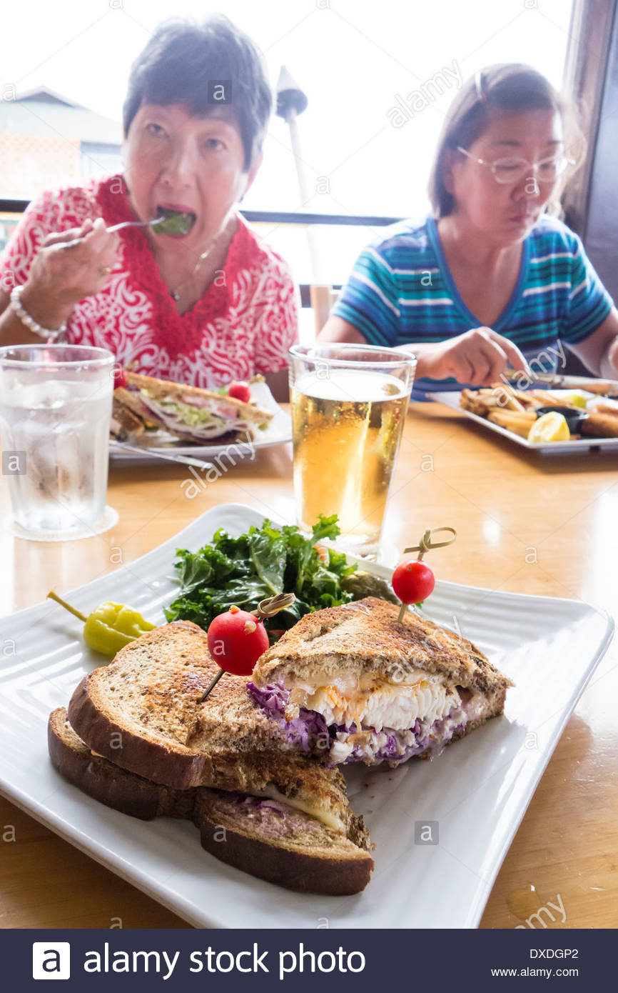 Fish Reuben sandwich beer for lunch with sisters when on holiday at Lahanai Fish House on Maui in the State of Hawaii USA - Stock Image