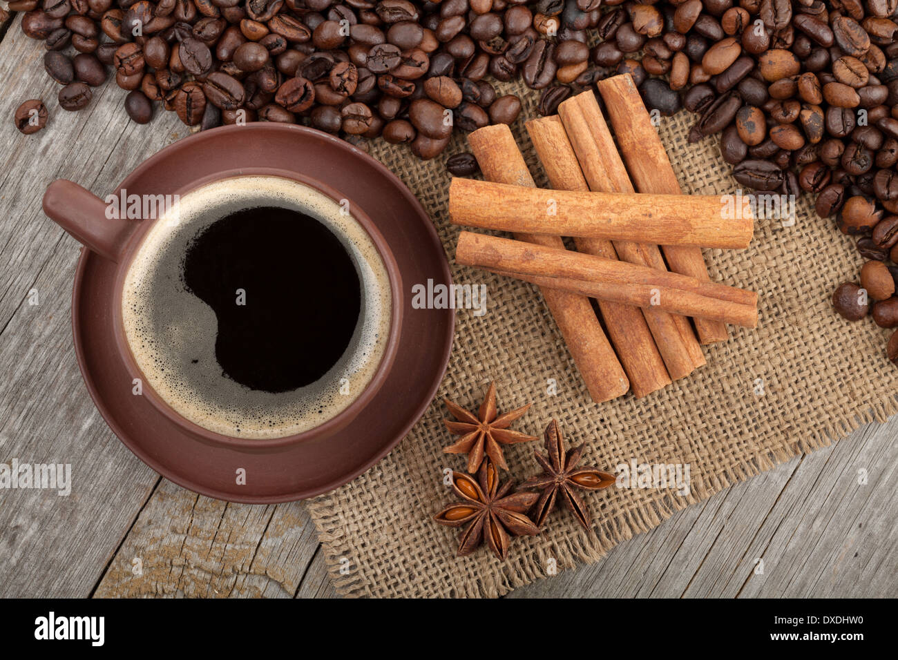 Coffee cup and spices on wooden table texture - Stock Image