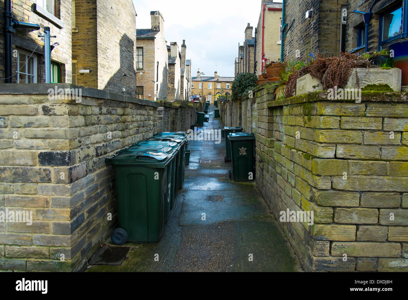 Rubbish bins outisde houses built for the workers at Salt's Mill, Saltaire, Bradford, Yorkshire, England. - Stock Image
