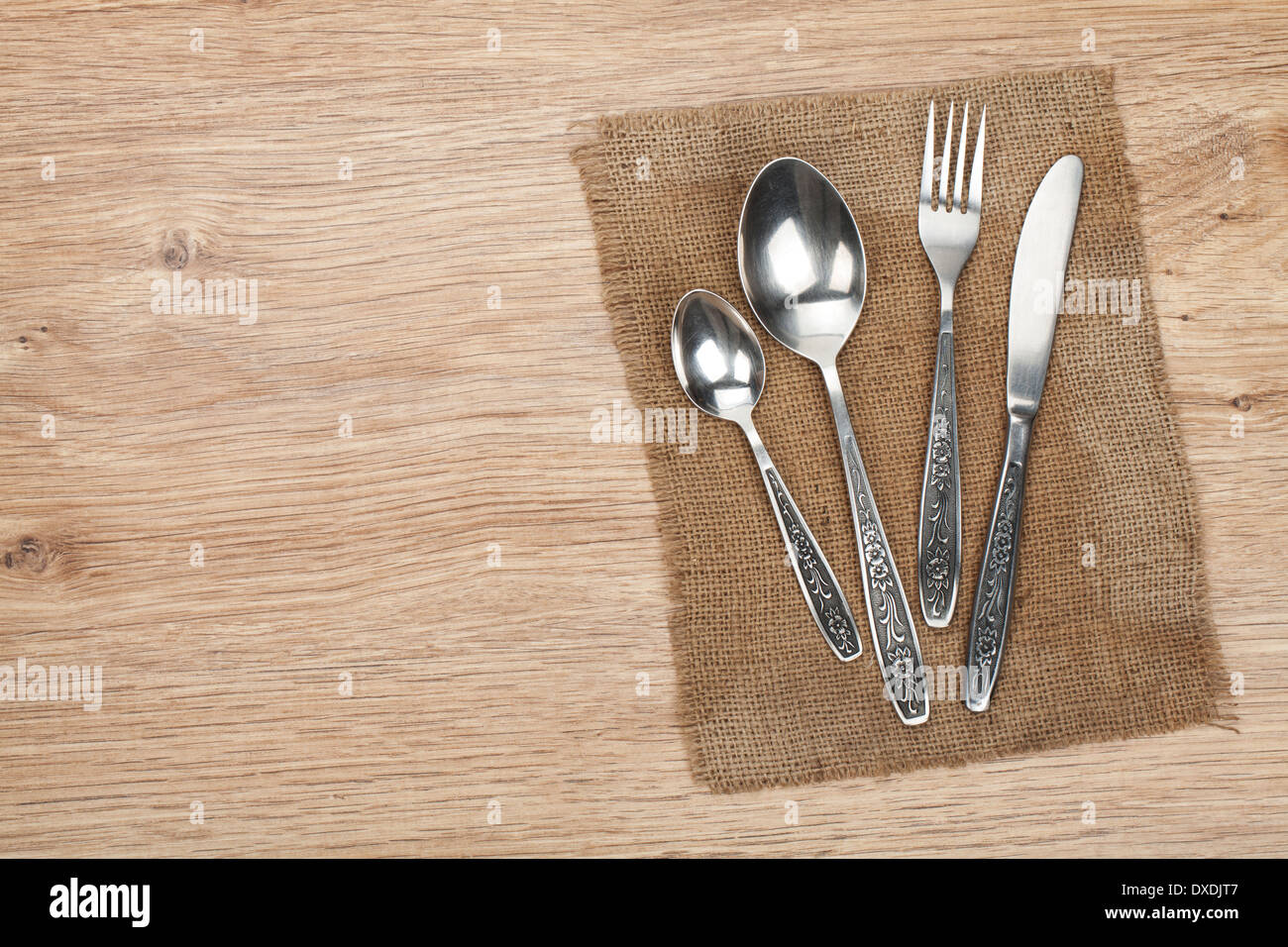 Silverware or flatware set of fork, spoon and knife on wooden table ...