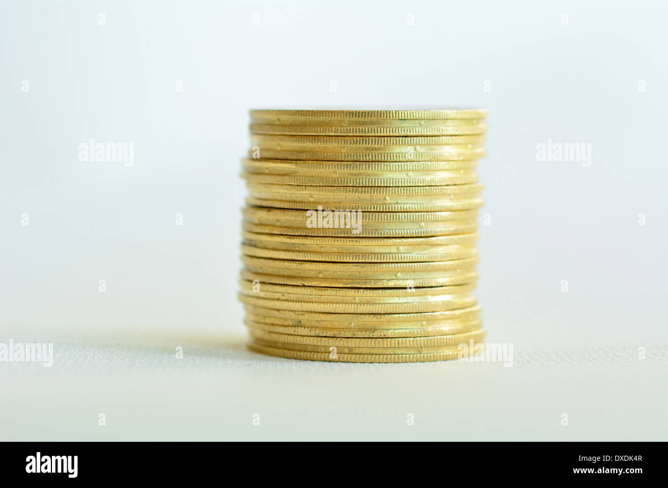 One Golden gold coins stack isolated on white background. Concept photo of bank, money, banking, finance, economy, saving,loans - Stock Image