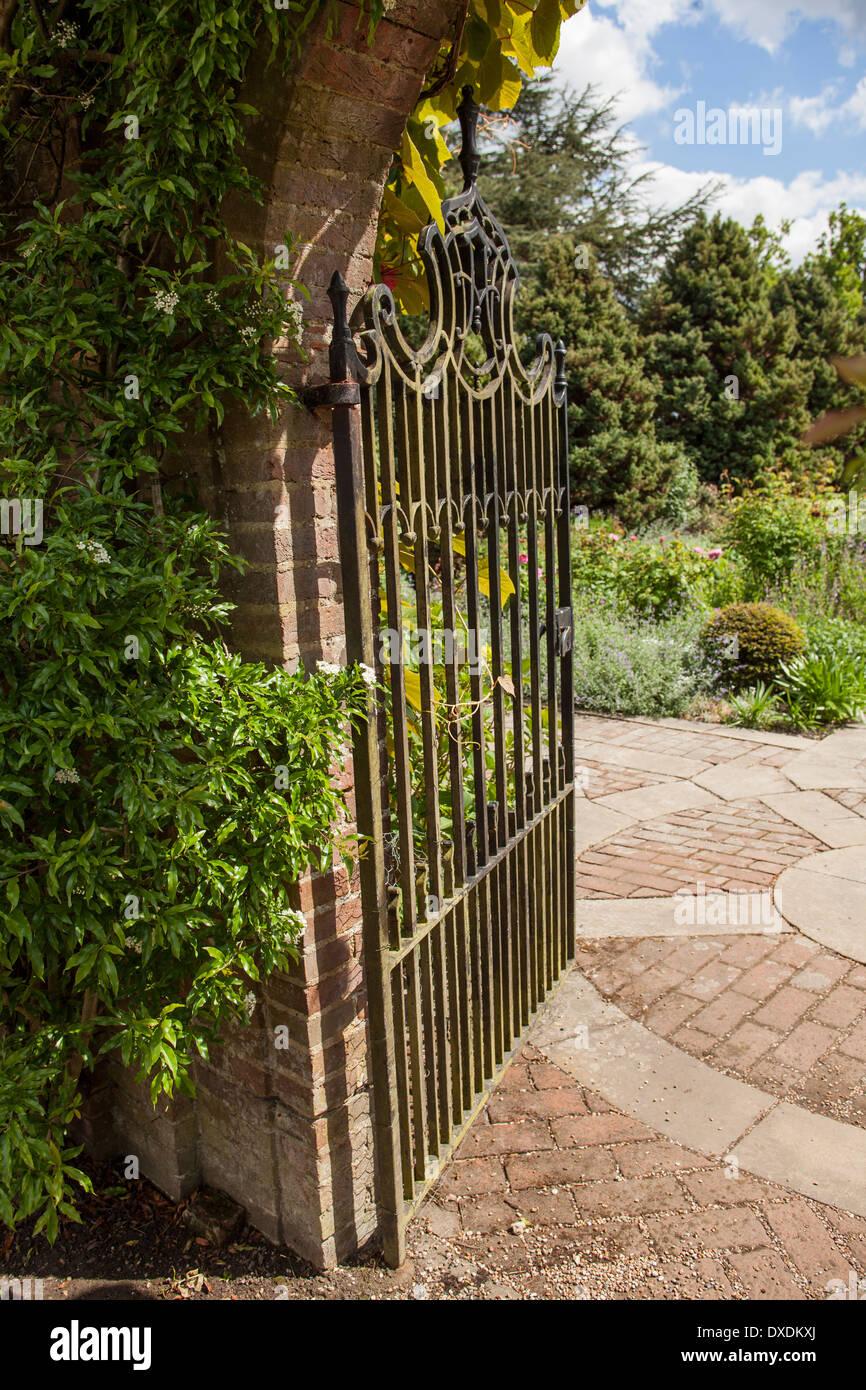 Wrought iron garden gate looking onto garden Stock Photo: 67913178 ...