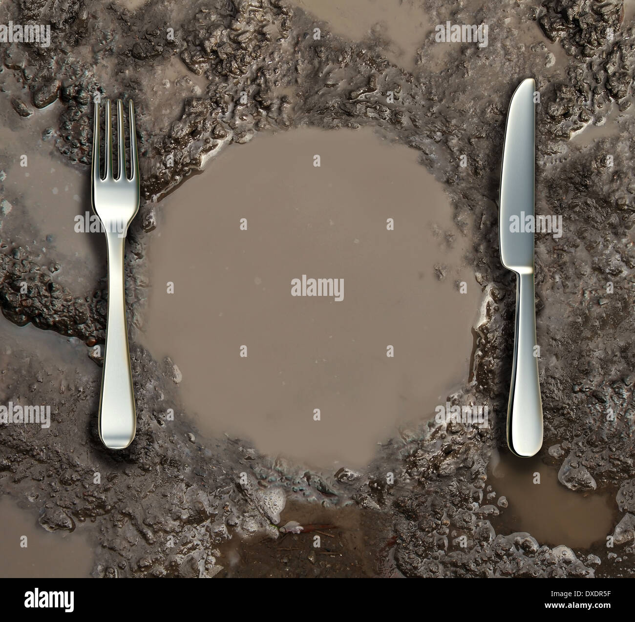 Food sanitation concept and global poverty symbol as a wet ground with a mud puddle of dirty water shaped as a dinner plate with a silver fork and knife as a metaphor for contamination health risk. - Stock Image