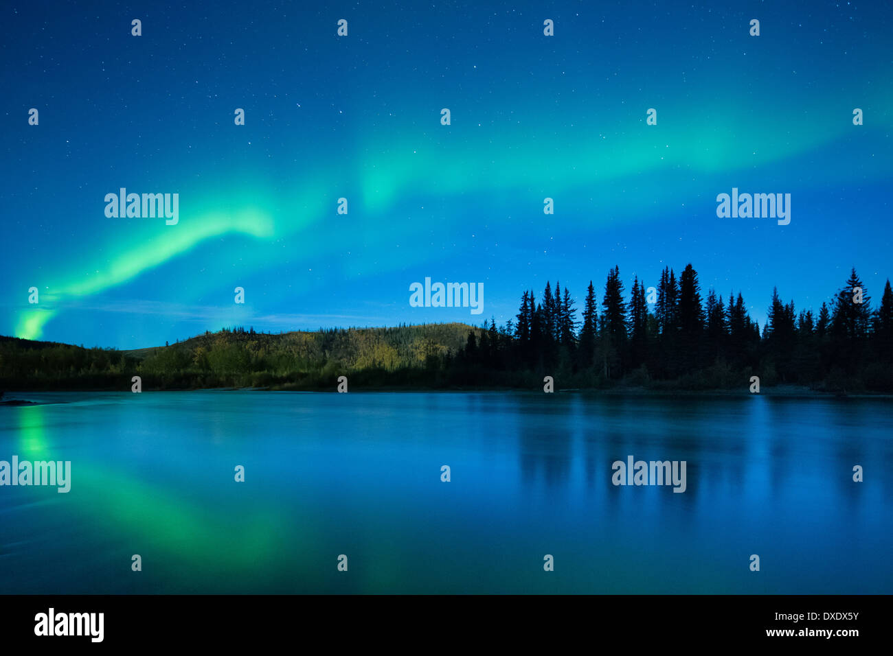 The Aurora Borealis (Northern Lights) over the Klondike River, Yukon Territories, Canada Stock Photo