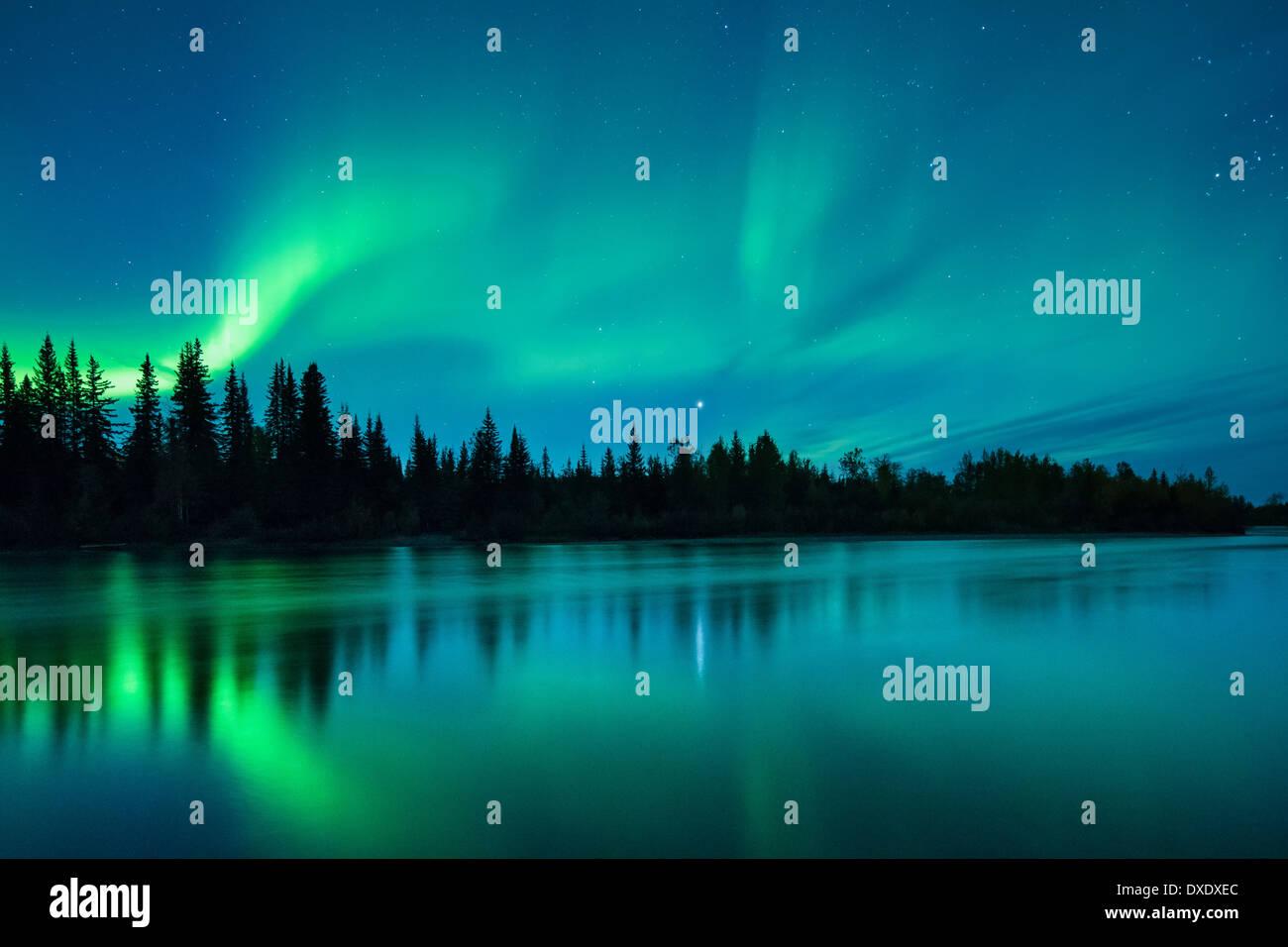 The Aurora Borealis (Northern Lights) over the Klondike River, Yukon Territories, Canada - Stock Image