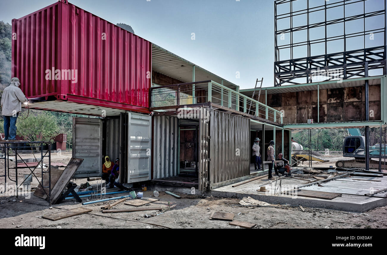 Large metal shipping containers in the course of conversion to unusual residential homes. Thailand S. E. Asia - Stock Image