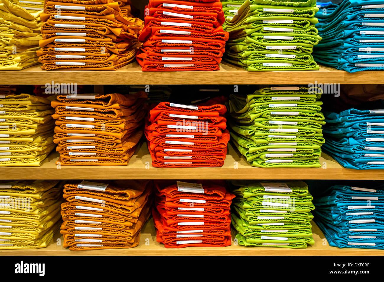 neat stacks of folded clothing on the shop shelves stock photo rh alamy com neat shelves neat shelves