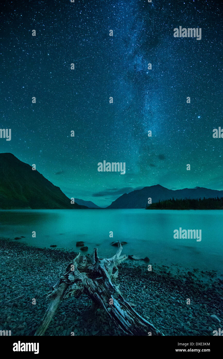 the Milky Way and night sky over Kathleen Lake & the St Elias Mountains, Kluane National Park, Yukon Territories, Canada - Stock Image