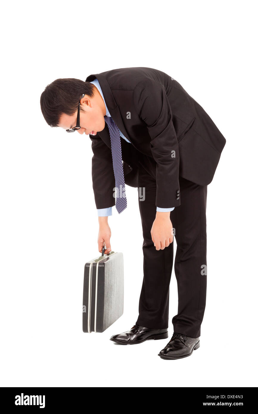 exhausted businessman stoop and holding briefcase isolated on white - Stock Image