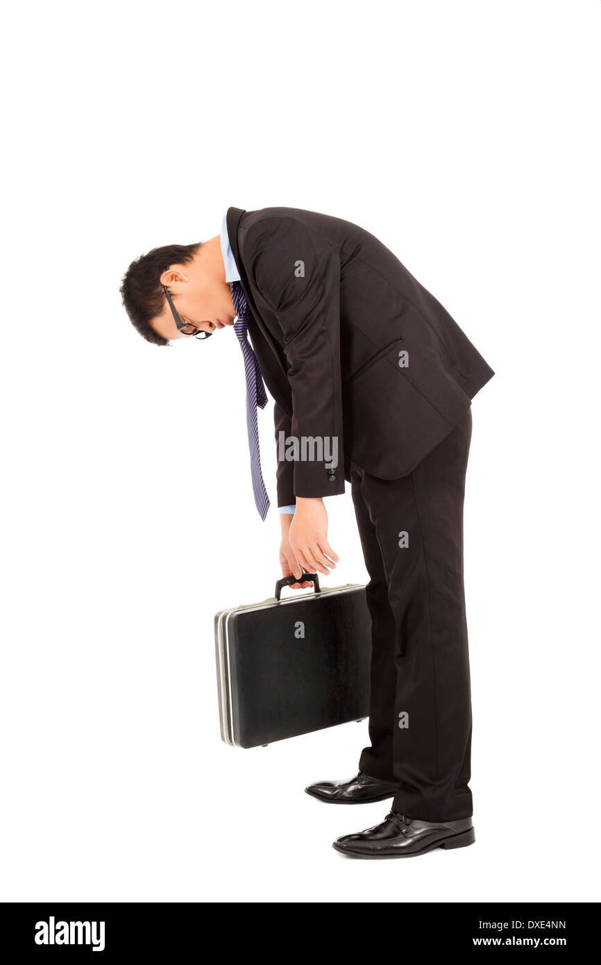 very tired businessman stoop and holding briefcase over white background - Stock Image