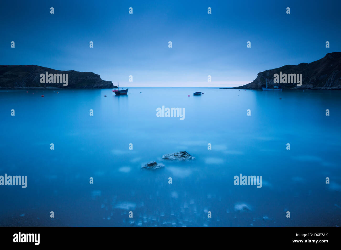 Lulworth Cove at dusk, Jurassic Coast, Dorset, England - Stock Image