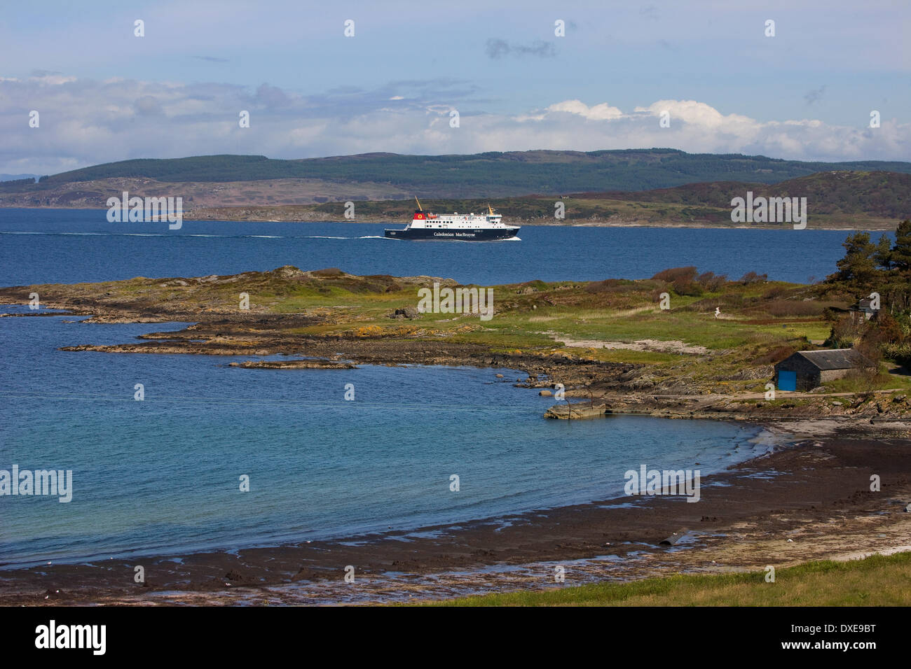 Cal Mac ferries latest car ferry the Finlaggan enters west loch tarbert en route from islay.argyll - Stock Image