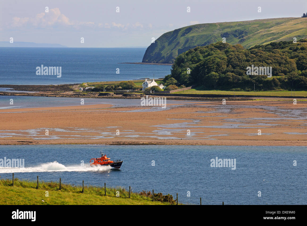 Campbeltown lifeboat at speed passing Davaar island, Campbeltown Loch, Argyll - Stock Image