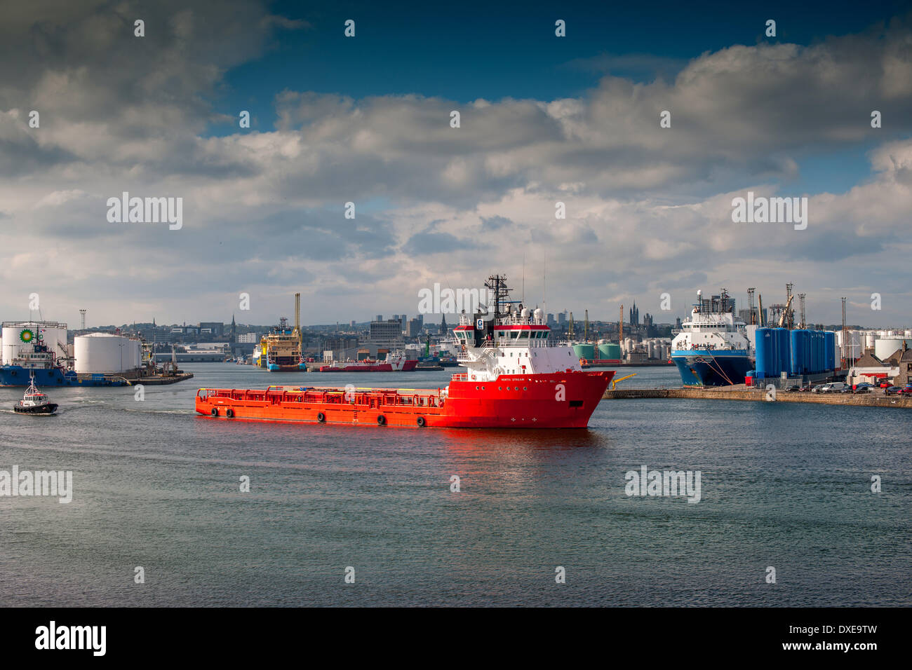 A busy scene in Aberdeen harbour with oil related ships and vessels in view.Aberdeenshire,scotland. - Stock Image