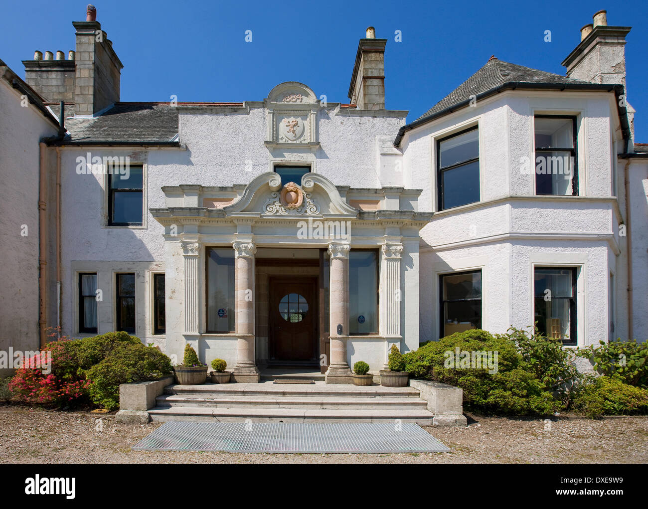 Achmore house from gardens, Isle of Gigha, Argyll - Stock Image