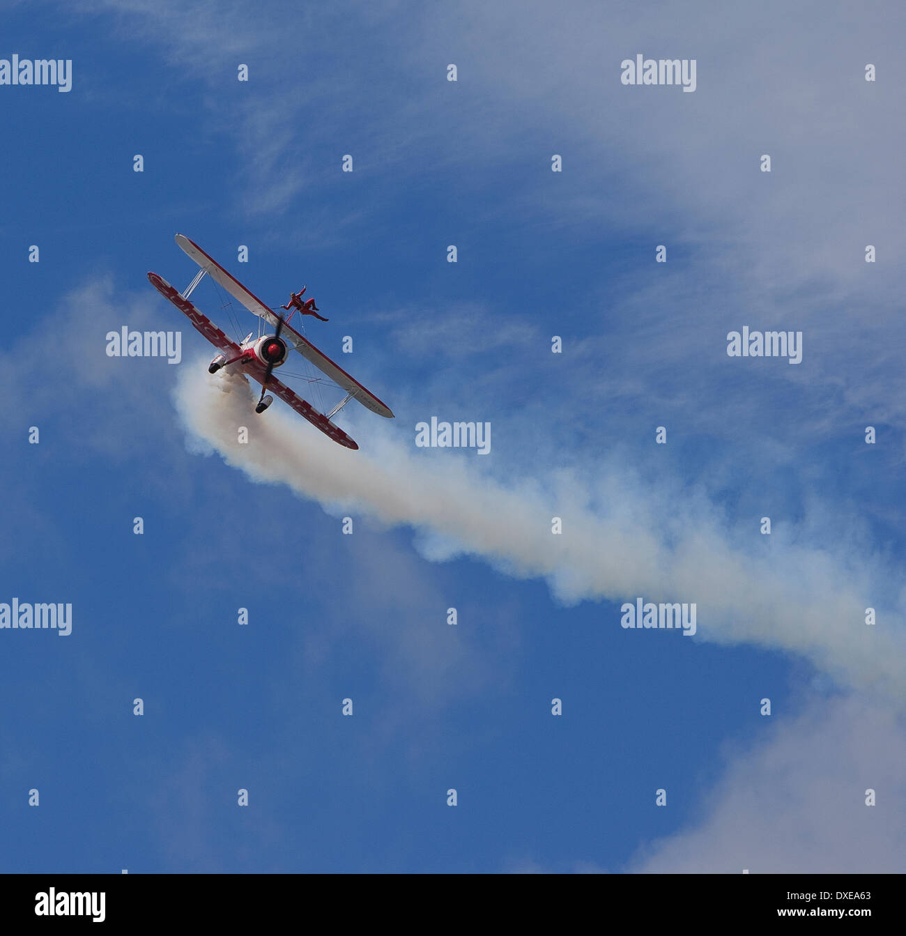 A Wing walker on a single engine bi-plane at an airshow in britain. - Stock Image