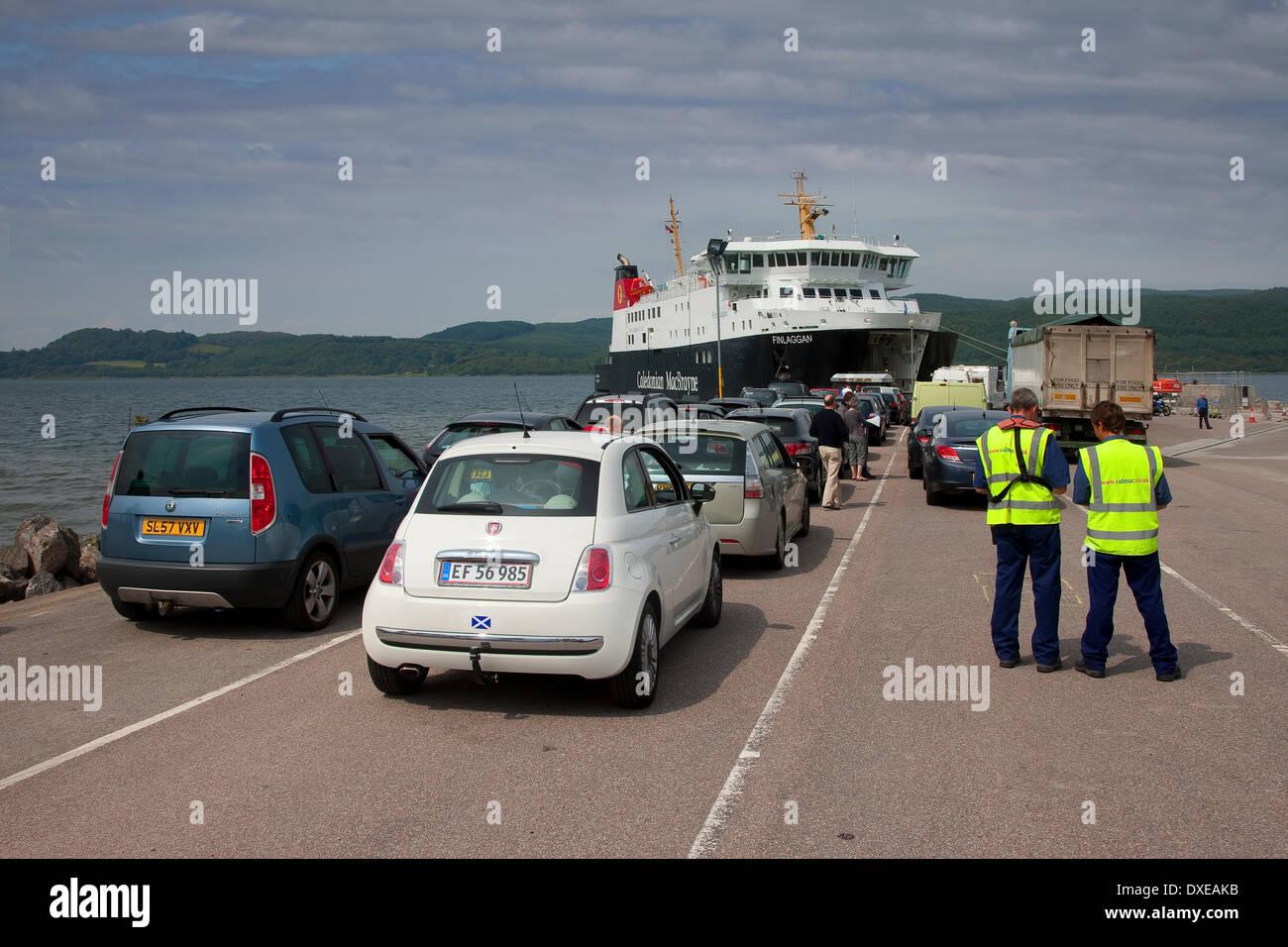 cars being loaded onto Caledoniann MacBrayne vessel 'MV Finlaggan' at Kennicraig Pier, West Loch Tarbert. - Stock Image