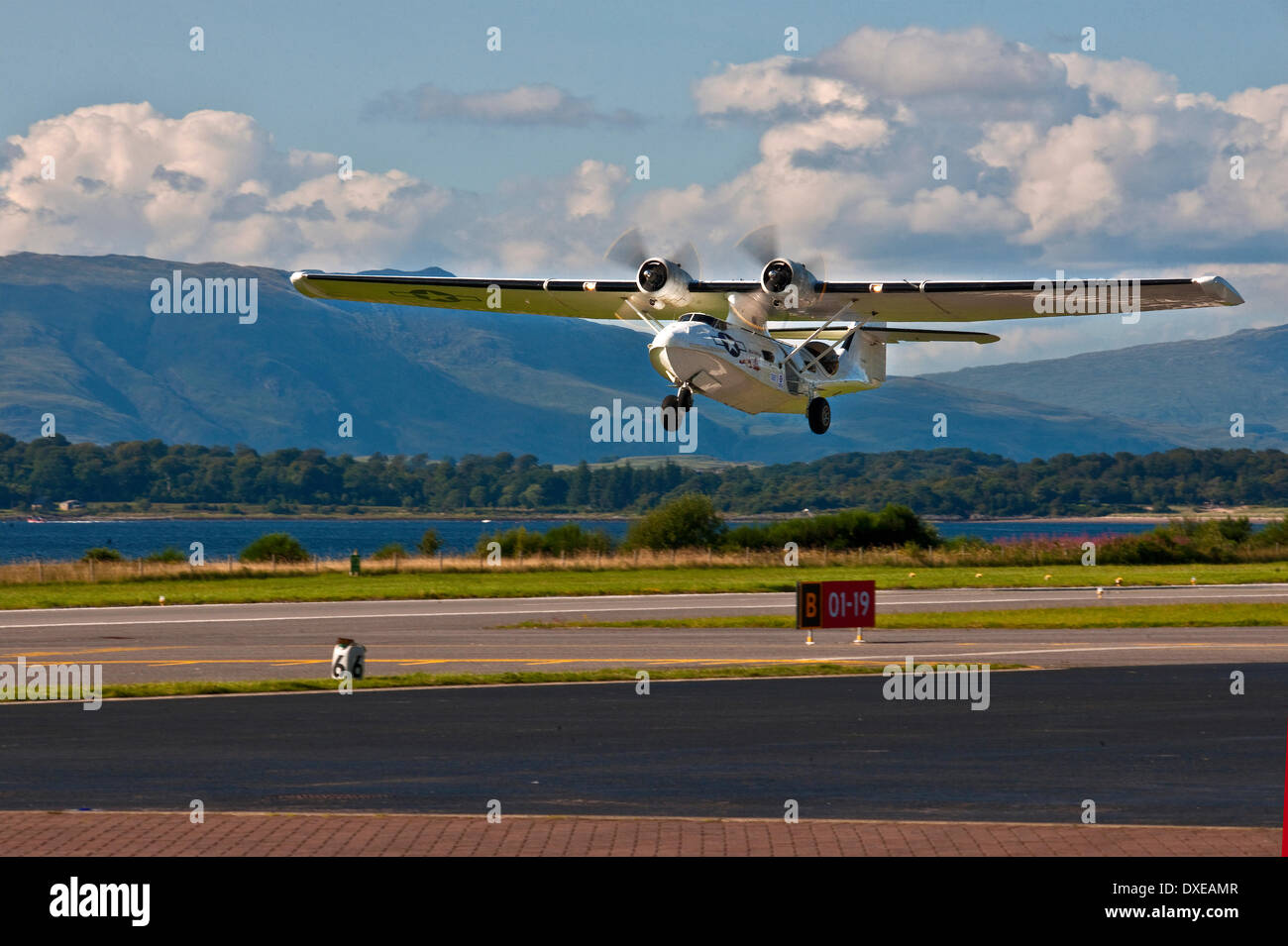 A world war two Catalina PBY flying boat arriving at Oban airport in 2013 - Stock Image