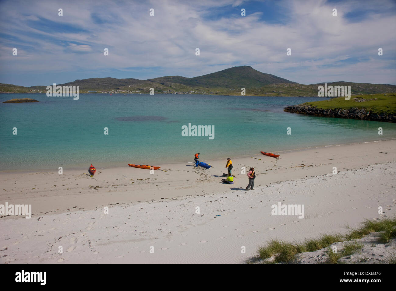 Beautiful sandy beach on the island of Vatersay with castlebay, Isle of Barra in view. Stock Photo