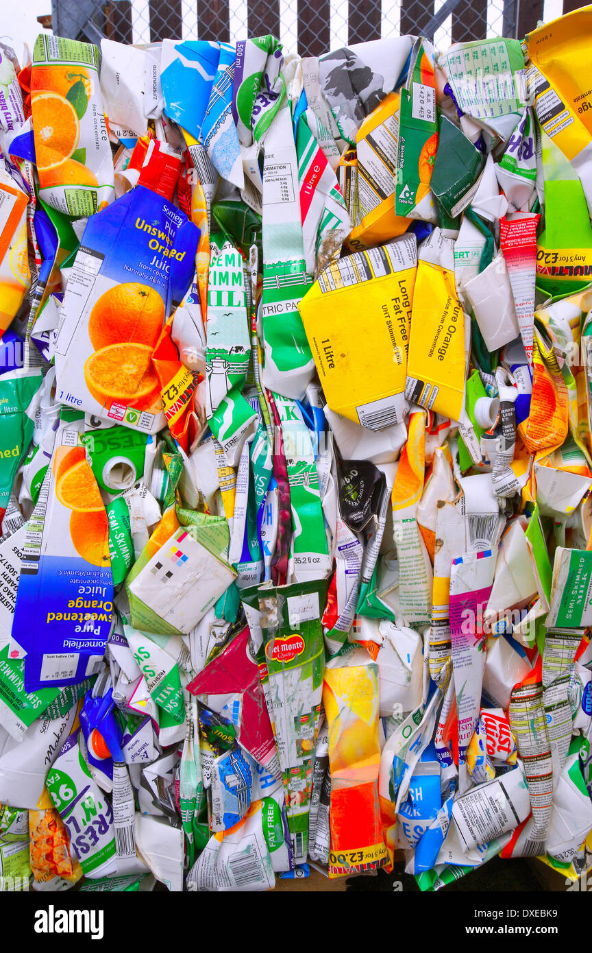 compressed cardboard cartons ready to be recycled. - Stock Image