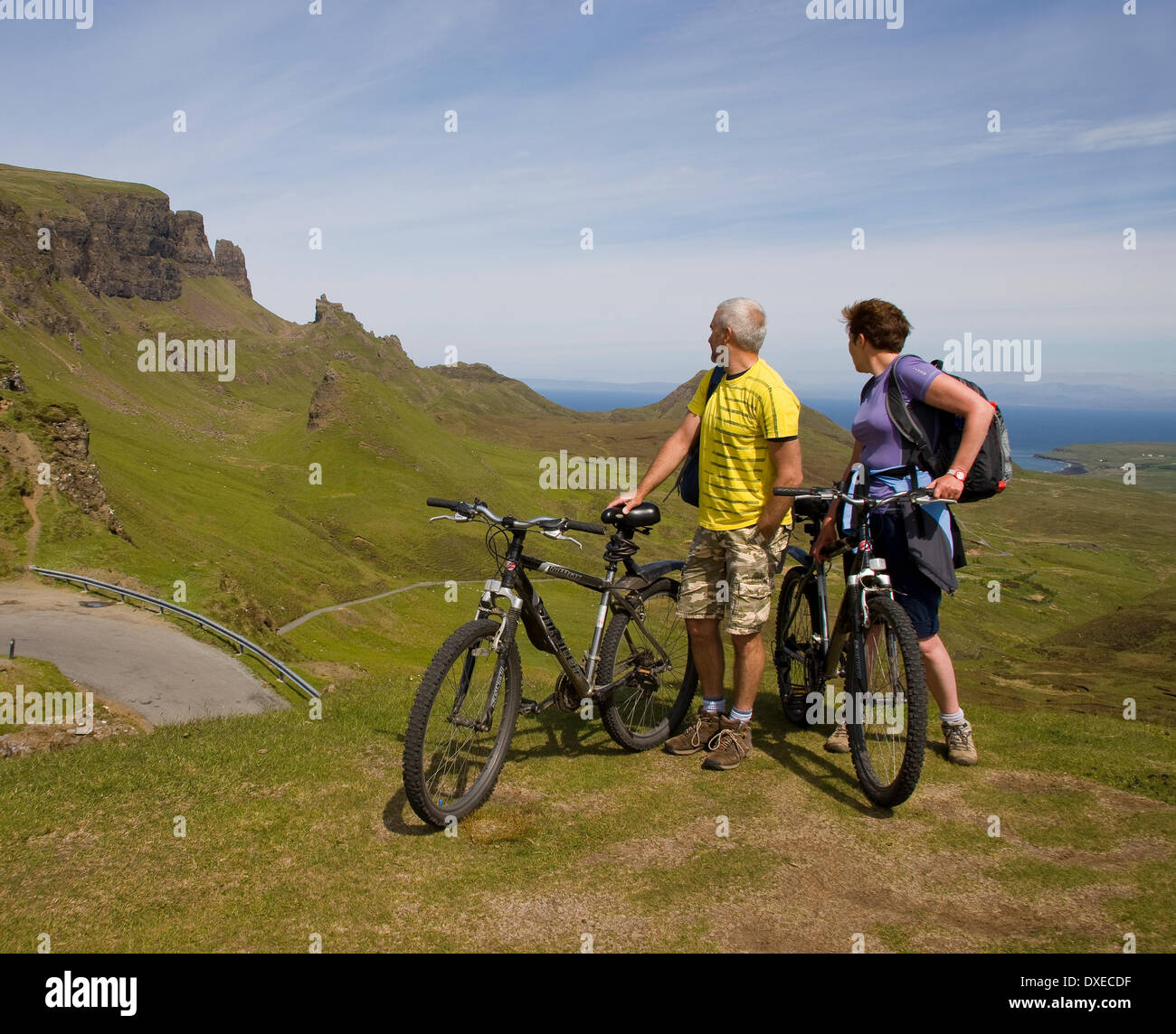 Cyclists pause at the Quiraing, Storr Rock nr Staffin, Isle of Skye - Stock Image