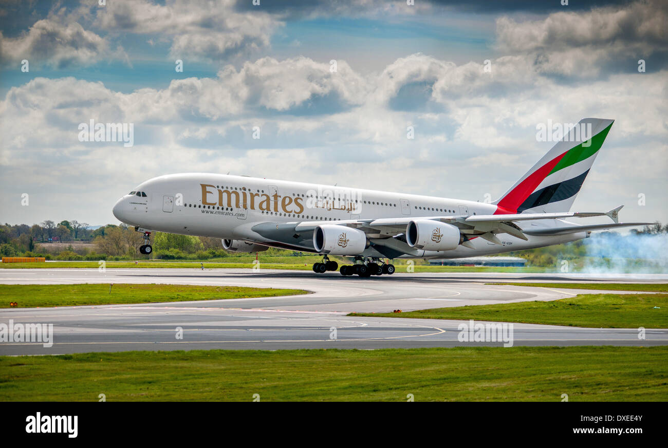 An Emerates airline airbus A380 super jumbo landing at manchester airport 2012 england - Stock Image