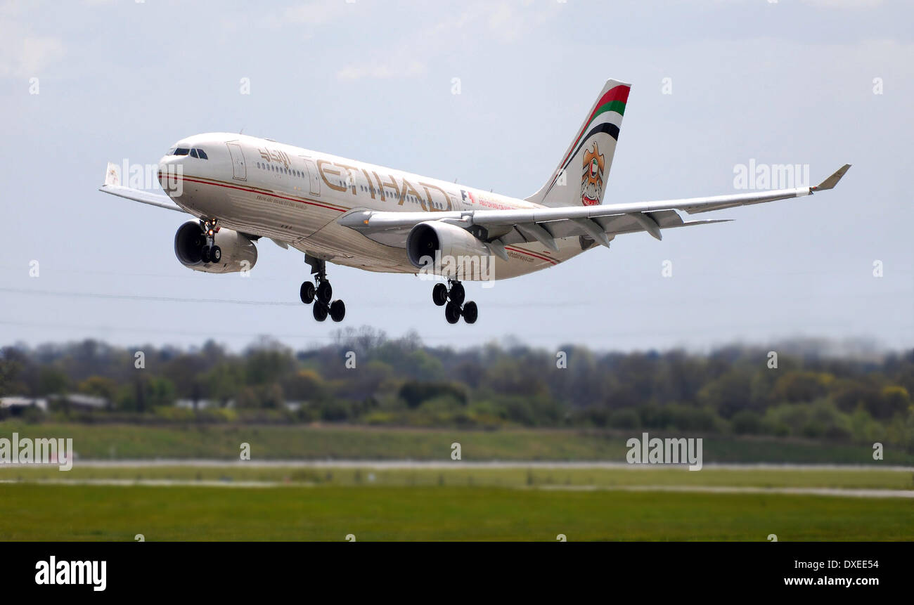 An Etihad airline airbus A330 landing at manchester airport england 2013 - Stock Image