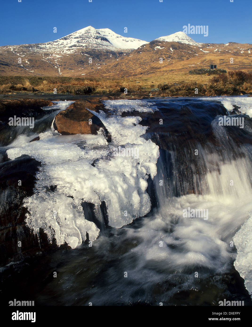 Icy waterfall in Glen More with ben More.Island of Mull,Argyll - Stock Image
