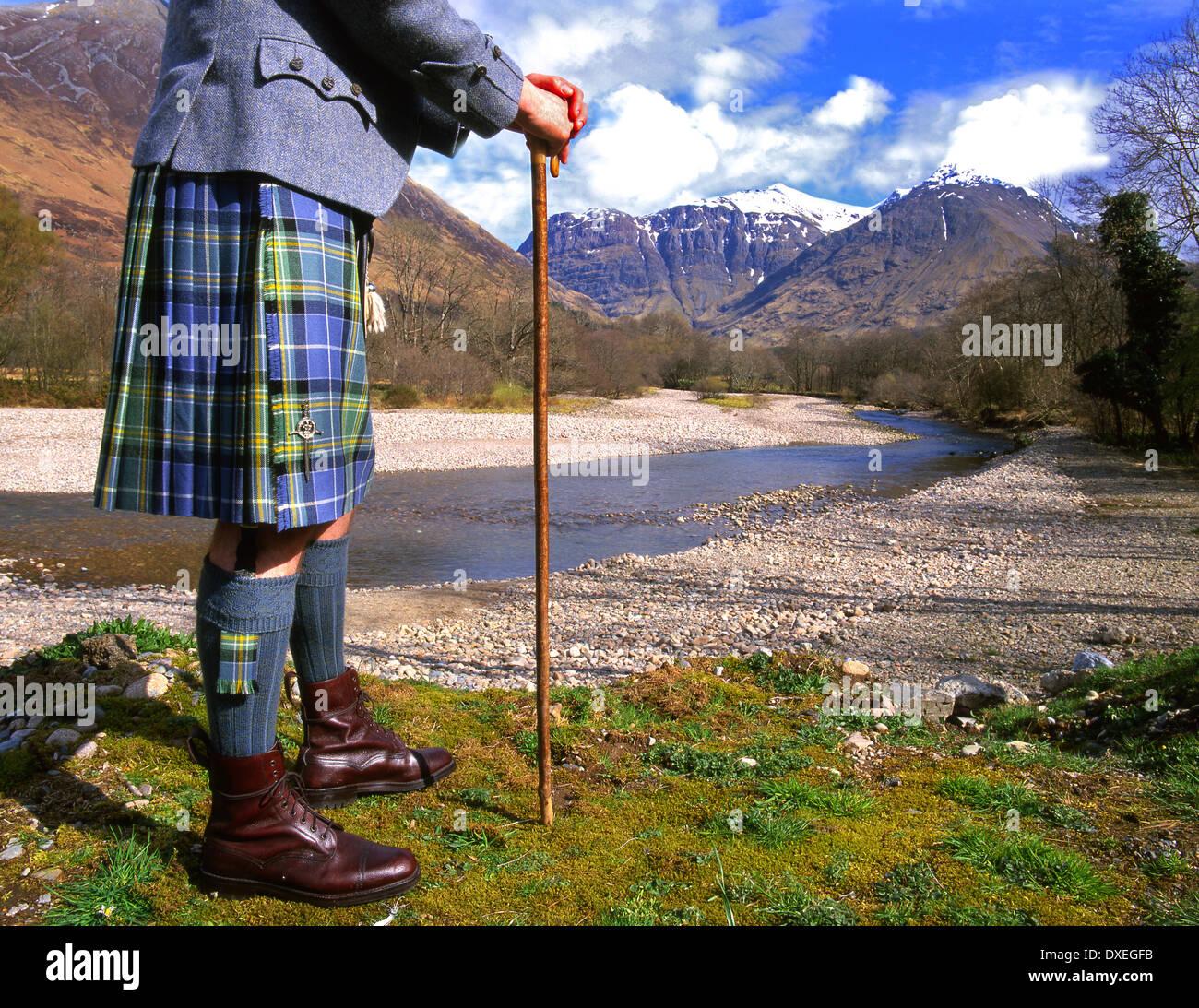 Tartan clad highlander admires the splendour of Glencoe,  West Highlands. - Stock Image