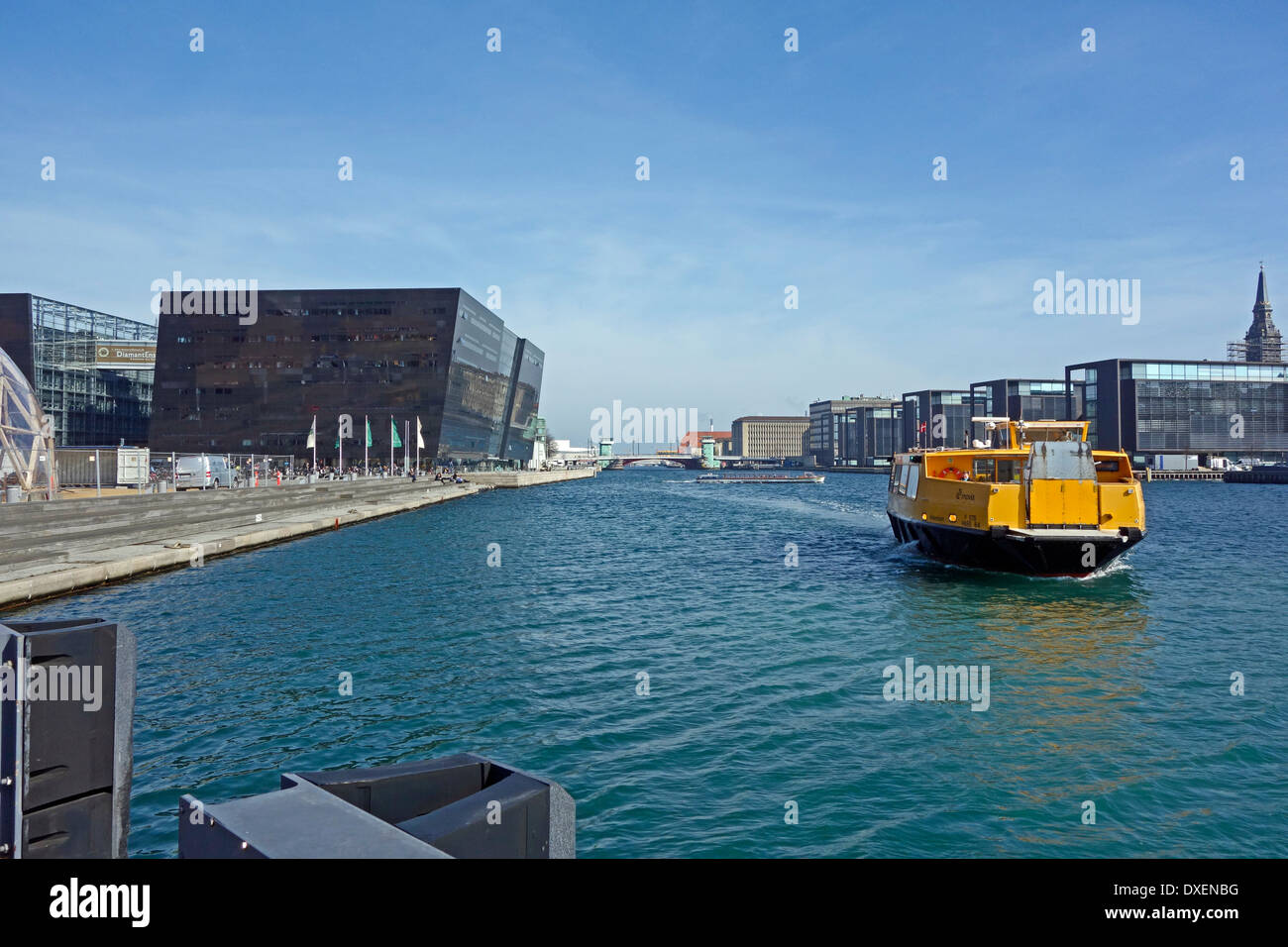 New Movia water bus approaches The Royal Danish Library  (the Black Diamond) stop on the waterfront in Copenhagen - Stock Image