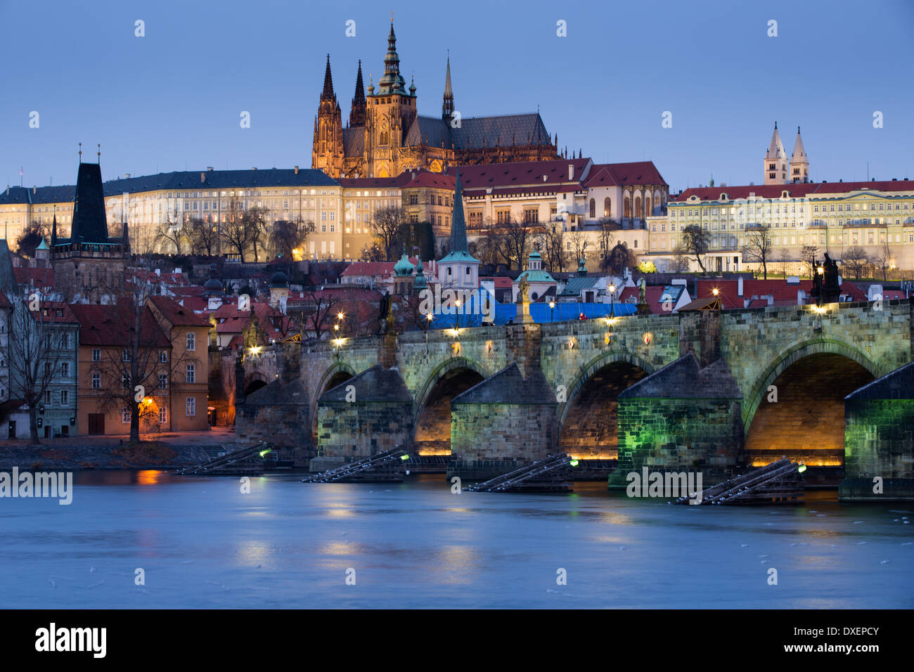 the Castle District, St Vitus Cathedral and the Charles Bridge over the River Vltava at dusk, Prague, Czech Republic - Stock Image