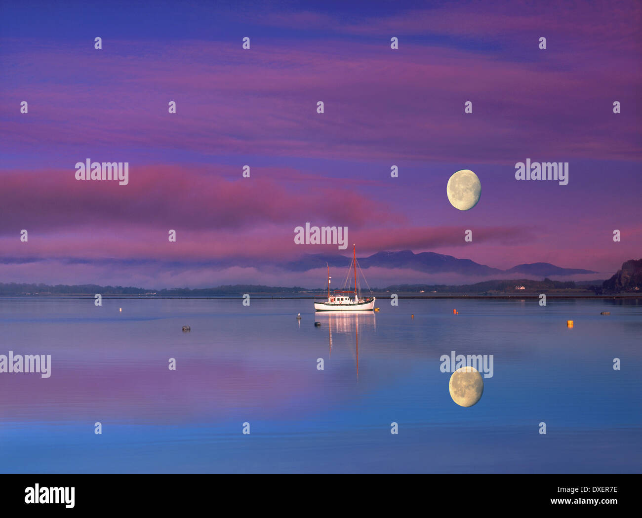Moonrise and sunset over ardmuchnish bay by connel,argyll. - Stock Image