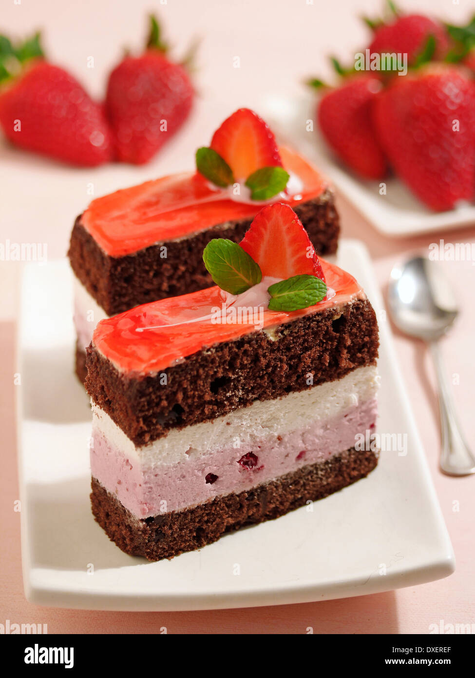 Sponge cake with cream and strawberries. Recipe available. Stock Photo