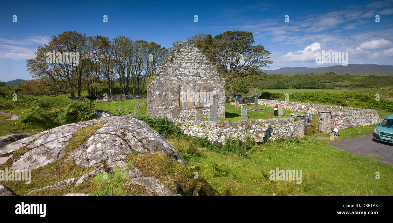 Tourists visit Kildalton Chapel, Islay - Stock Image