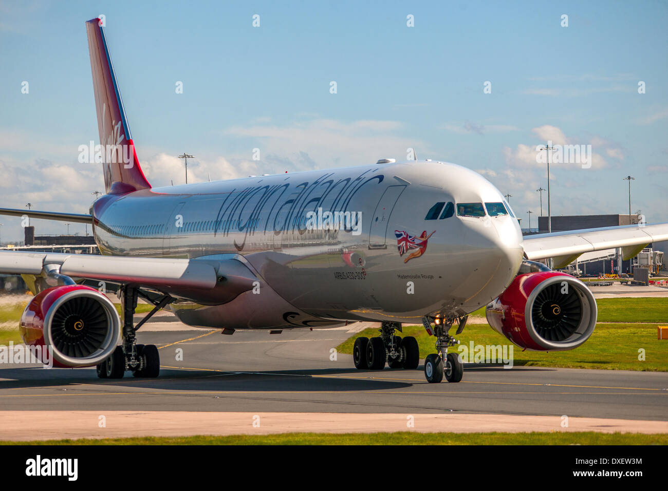 A brand new virgin atlantic airbus A330-300 departs manchester airport 2012 england - Stock Image