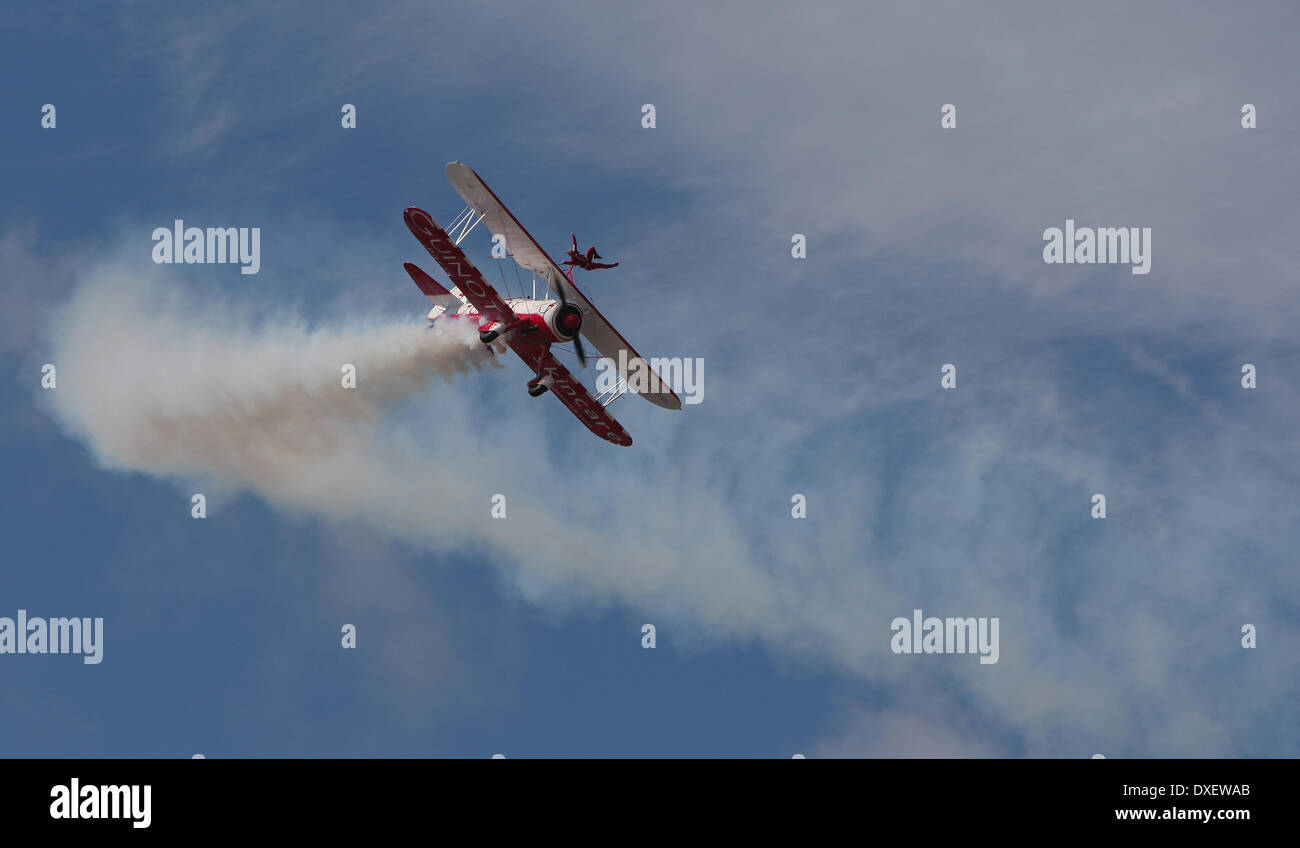 A stunt bi-plane with a wing walker displays at a english airshow over blackpool,lancs - Stock Image