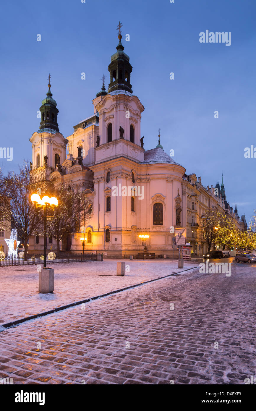 the Church of St Nicholas with a smattering of snow and Christmas lights in the Old Town Square, Prague, Czech Republic - Stock Image