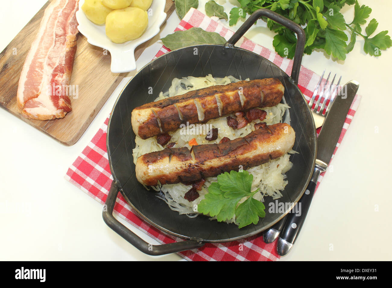 a pan with sourcrout and fried sausage Stock Photo